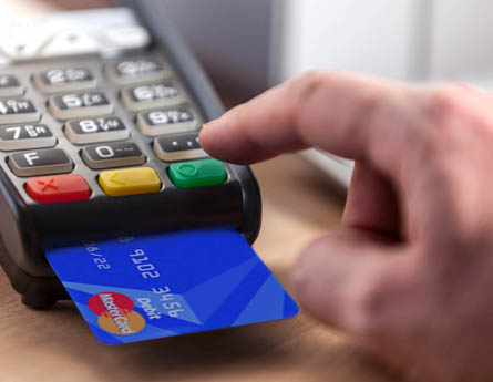 Chip card being used in device to make payment.