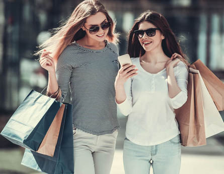 Two women shopping.